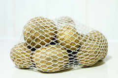 Aardappels in een zak Stock Afbeeldingen