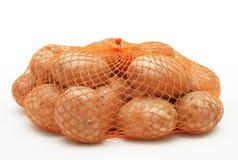 Aardappels in koord-zak royalty-vrije stock foto's