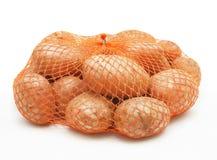 Aardappels in koord-zak stock afbeelding