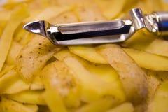 Aardappelschillen Stock Foto