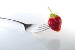 Aardbei met vork. Stock Afbeelding