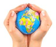 Aarde binnen handen stock fotografie