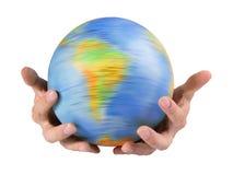 Aarde in handen Stock Foto's