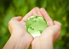Aarde in handen. De Wereld van het glas Royalty-vrije Stock Foto's