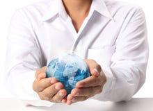 Aarde in menselijke hand Royalty-vrije Stock Foto's