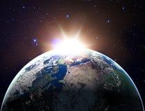Aarde met zonlicht Stock Afbeelding