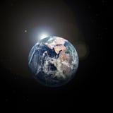 Aarde van ruimte en zon erachter Royalty-vrije Stock Afbeelding