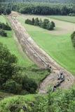 Aardgasleidingsbouw stock afbeeldingen