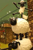 Aardman-` s Shaun die Schafcharaktere auf display at Expocity Stockfotografie