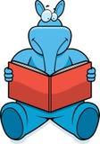 Aardvark Reading. A cartoon aardvark reading a book and smiling Royalty Free Stock Photos
