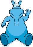 Aardvark Sitting. A cartoon aardvark sitting and smiling Stock Photography