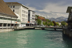 Aare reiver from city of Thun with Swiss Alps in background, Switzerland Royalty Free Stock Images