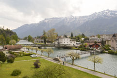 Aare river and Alps in Interlaken. Switzerland. View of the River Aare in Interlaken and snowy Alps (Jungfrau Mountain royalty free stock images