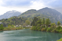Aare river and Alps in Interlaken. Switzerland. View of the River Aare in Interlaken and snowy Alps (Jungfrau Mountain Stock Image