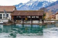 Aare river in Interlaken, Switzerland. Beautiful scenic picture of Interlaken town in Switzerland, Aare river in the mountains stock image