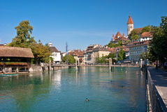 Aare river, thun, switzerland. The aare river, which flows from lake thunersee, through the village of thun, switzerland Stock Images