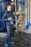 AARHUS, Denmark - April 13, 2015: A guide giving a tour around a. A guide giving a tour around a modern water plant station in Aarhus stock photos