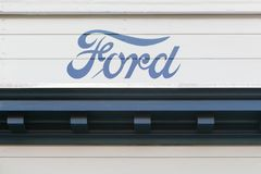 Vintage Ford logo on a wall. Aarhus, Denmark - August 28, 2017: Vintage Ford logo on a wall. Ford is an American multinational automaker headquartered in Royalty Free Stock Images