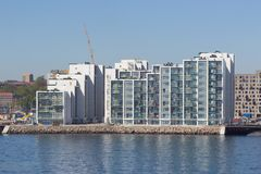 View from the sea side to the residential complex Isbjerget in Aarhus, Denmark. Aarhus, Denmark - May 20, 2016: View from the sea side to the residential Royalty Free Stock Images