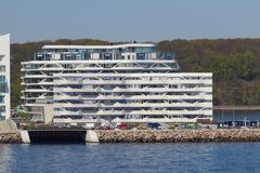 View from the sea side to the residential complex Isbjerget in Aarhus, Denmark. Aarhus, Denmark - May 20, 2016: View from the sea side to the residential Stock Images