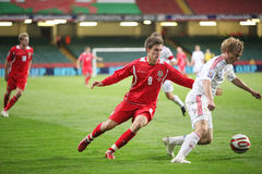 Aaron Ramsey Wales. Aaron Ramsey (left) of Wales and Alexei Rebko (right) of Russia fights for the ball during their 2010 World Cup Qualifiying match against Stock Photo