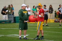 Aaron Rodger & Mike McCarthy of Green Bay Packers. Green Bay Packers Quarterback Aaron Rodgers Talks with Head Coach Mike McCarthy During Training Camp Practice Royalty Free Stock Photos