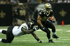 Aaron Stecker. Breaks a tackle during the Jaguars VS Saints Game in the Superdome
