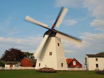 Aarsdale molle. Dutch windmill built in 1877 with Aarsdale town on the Danish island of Bornholm. One of the most interesting sights of this picturesque island Stock Image