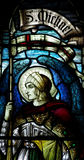 Aartsengel Michael in gebrandschilderd glas Stock Foto's