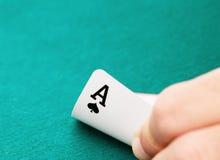 Aas van spades ter beschikking Royalty-vrije Stock Foto's