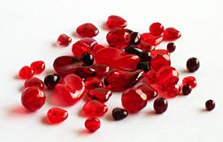 Aassorted red glass beads. On white Stock Image