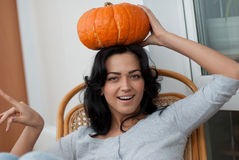 AAttractive girl with holding pumpkins  in here ha Stock Photos