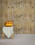 Abóbora de Dia das Bruxas com fundo de madeira Fotografia de Stock Royalty Free