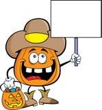 Abóbora dos desenhos animados vestida como um vaqueiro que guarda um sinal Imagem de Stock