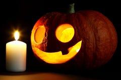 Abóbora e vela de Dia das Bruxas Fotografia de Stock Royalty Free