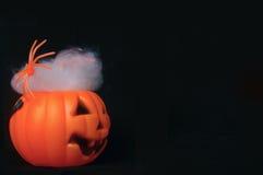 Abóbora falsificada com spiderwebs Fotografia de Stock Royalty Free