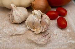 Abóboras com cebola, alho e tomates Fotos de Stock