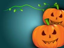 Abóboras de Halloween com folhas verdes. Foto de Stock Royalty Free