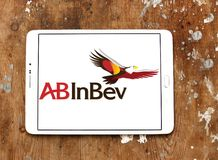 AB InBev beer company logo. Logo of AB InBev beer on samsung tablet on wooden background. Anheuser-Busch InBev is a Belgian–Brazilian beverage and brewing Stock Image