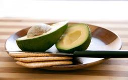 Abacate com biscoitos Imagem de Stock