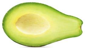 Abacate cortado dentro parcialmente imagem de stock