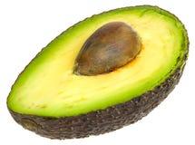 Abacate cortado dentro parcialmente Foto de Stock