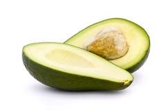 Abacate cortado dentro parcialmente com pedra Imagem de Stock Royalty Free
