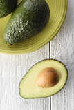 Abacate cortado em um fundo branco Foto de Stock Royalty Free