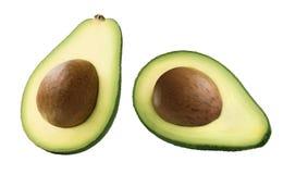 Abacate dobro meio com a semente isolada no branco fotografia de stock