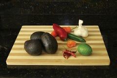Abacates com pimentas, alho e cal Foto de Stock Royalty Free