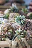 Abacaxis no close up da cesta Imagem de Stock Royalty Free
