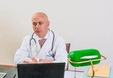 Aback doctor in his studio. Royalty Free Stock Photo