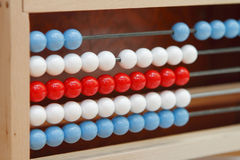 Abacus. Colorful educational toy: abacus on the table Stock Images
