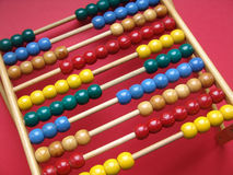 Abacus. With ten bars and colorful beads Stock Photos